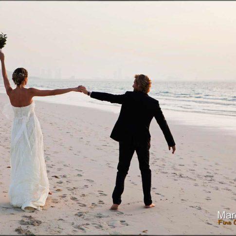 portrait de mariés à la plage